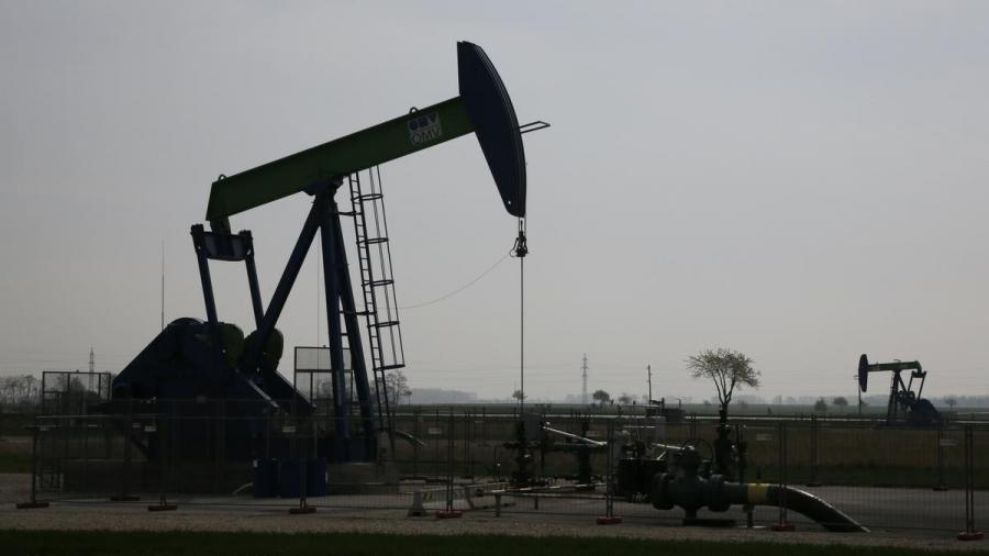 Oil prices slip on surprise U.S. crude build